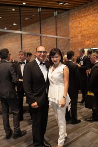 Lui Petrollini, EY Pacific Program Director with Nicole Yang, owner Leone's Store.