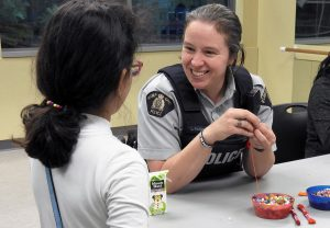 Cst. Leia Paddon engages with young female as part of Girls Got Game initiative.