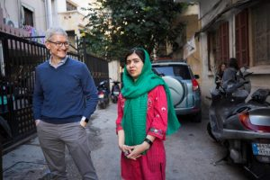 Tim Cook and Malala Yousafzai outside the home of a family with daughters attending school in Beirut, Lebanon supported by Malala Fund. (Photo: Apple)