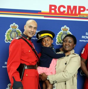 New Canadians pose with members of the Royal Canadian Mounted Police.
