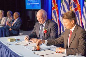 Premier John Horgan with Vancouver mayor Gregor Robertson