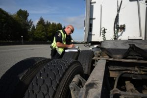 Cst. Usipiuk writes a ticket during the commercial vehicle enforcement blitz.